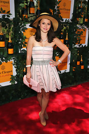 Sasha Cohen showed off her athletic figure with this shoulder-bearing strapless dress in a soft pink and gray coloring.