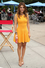 Maria chose a figure-flattering sunny orange A-line dress for her appearance at an event in NYC.