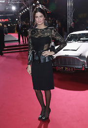 Shermine Shahrivar pulled off an elegant look by wearing a peplum dress with a lace bodice.
