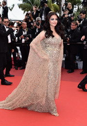 Aishwarya Rai was easily the queen of the night in this caped, beaded gold gown by Ali Younes Couture during the Cannes premiere of 'Slack Bay.'