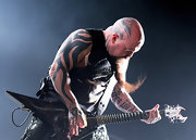 Kerry King has a large lettering tattoo on the inside of his left arm.