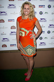 Chemmy Alcott looked lovely in a red dress that featured tribal-print detailing.