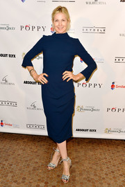 Kelly Rutherford opted for a simple yet stylish high-neck navy midi dress when she attended the World Smile Day celebration.