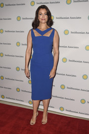 Bellamy Young donned a sleek and modern blue sheath dress with a cutout neckline for the 'Scandal-ous!' event.