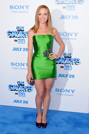 Jayma Mays looked brilliant in a shining green strapless structured dress with a floral sequined applique' at her hip. The redhead's locks looked sun-kissed and she paired the vibrant look with satin plum heels.