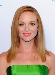 Jayma Mays proves that she is not afraid of color at 'The Smurfs' premiere. She wore a bright green mini dress paired with deep purple pumps and bright coral lips.