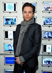 Thomas Dekker dressed down his blazer with this casual patterned scarf.