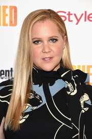 Amy Schumer opted for a simple straight style when she attended the New York premiere of 'Snatched.'