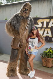 Nicole Polizzi really got into the Disney spirit with this Mickey Mouse tank top and cap combo during a visit to the Hollywood Studios theme park.