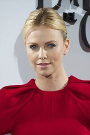 Charlize Theron wore her hair styled in a sleek classic ponytail for a photocall of 'Snow White and the Huntsman.'