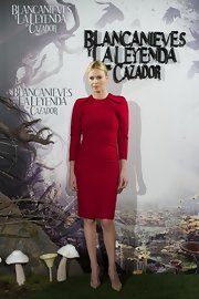 Charlize Theron was red hot in this gathered-sleeve cocktail dress.