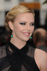 Charlize Theron had her hair styled in a sleek retro-inspired 'do for the world premiere of 'Snow White and the Huntsman.'