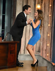 Sofia Vergara finished off a shimmering blue shift with these sky-high black platform pumps.