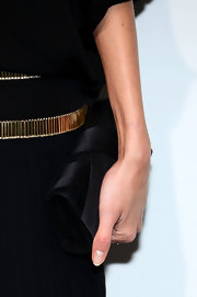 Anja Rubik accessorized with an elegant black satin clutch at the Soiree Chopard Mystery Party.