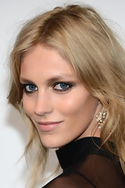 Anja Rubik arrived at the Chopard Mystery Party with her eyes dramatically done up in gray shadows and black liner.