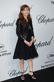 Isabelle Huppert toughened up her girly LBD with a black leather motorcycle jacket at the Soiree Chopard 'Mystery Party.'