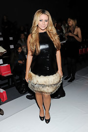 Aubrey is always one for a daring look. The starlet opted to wear a leather cocktail dress with fur trim to the Son Jung Wan Fashion Show.