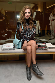 Chiara Ferragni attended the Sonia Rykiel show carrying a leather shoulder bag in a refreshing turquoise hue.