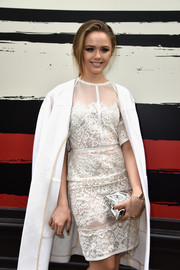Kristina Bazan paired a metallic silver chain-strap bag with her ladylike outfit for the Sonia Rykiel fashion show.