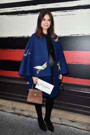 Miroslava Duma cut a regal figure in a Valentino bird-embroidered cape/coat during the Sonia Rykiel fashion show.