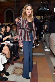 Olivia Palermo channeled the '70s with a pair of blue bell-bottoms, also by Burberry.