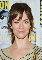 Maggie Siff donned multi-strand citrine earrings at the 'Sons of Anarchy' press con.