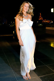 Victoria Azarenka glammed it up in a strapless evening gown made complete with bow detailing on the bodice.