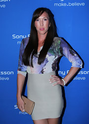 Jelena Jankovic paired a floral blouse with a tight nude mini skirt at the Sony Ericsson Open Players Welcome Party.
