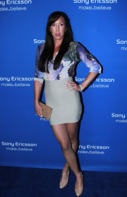 Jelena Jankovic attended the Sony Ericsson Open Players Welcome Party wearing a floral blouse, a mini skirt, and nude pumps.