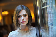 At the Sony Pictures Classic Cocktail Party during the 2011 Toronto International Film Festival, Keira Knightley wore some very sultry eye makeup. To recreate her look, try lining upper and lower lash lines with a rich, brown shadow, smudging slighty and applying black mascara.