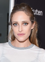 Carly Chaikin opted for a casual half-up hairstyle when she attended the premiere of 'The Wife.'