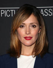 Rose Byrne brightened up her face with a swipe of red lipstick.