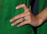 Brena Song accented her bright green frock with silver stackable rings.