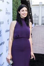 Jessica Pare paired a grid-patterned silver clutch with a purple frock for the Sony Pictures Social Soiree.