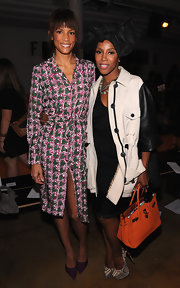 June Ambrose was spotted sporting an neon tote at the Sophie Theallet Spring 2013 presentation.