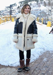 Sophia Bush completed her cold-weather ensemble with a pair of tan and black snow boots by Sorel.