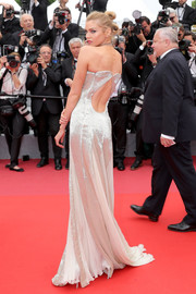 Stella Maxwell sizzled in a Roberto Cavalli Couture strapless gown with a cutout back and a plunging front at the Cannes Film Festival screening of 'Sorry Angel.'