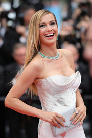 Petra Nemcova paired a silver envelope clutch with a strapless dress for the Cannes Film Festival screening of 'Sorry Angel.'