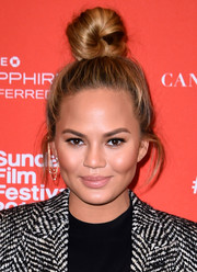 Chrissy Teigen looked funky with that huge knot balancing on top of her head during the Sundance Film Fest premiere of 'Southside with You.'