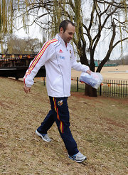 Soccer star Andres Iniesta wears Adidas track pants while traveling with the Spanish National Team.