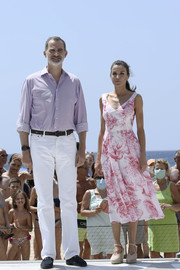 Queen Letizia embraced summer in a pink floral midi dress by Adolfo Domínguez while visiting Benidorm, Spain.
