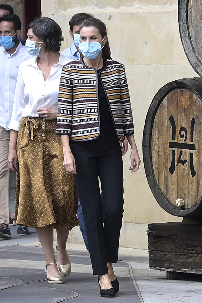 Queen Letizia looked smart in a cropped ethnic-print jacket by Uterqüe teamed with black slacks while touring Haro, Spain.