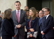 Princess Letizia was spotted at the Alimentaria gastronomic fair carrying a trendy gray foldover clutch.