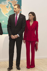 Queen Letizia of Spain suited up in this red Roberto Torretta set for the Commemoration of Capitulations of Valladolid.