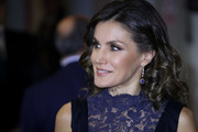 Queen Letizia of Spain matched her blue dress with a pair of dangling sapphire earrings when she attended a concert to commemorate the 40th anniversary of the Spanish Constitution.