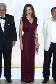 Queen Letizia of Spain looked downright elegant in a sleeveless burgundy jumpsuit by Angel Schlesser at a dinner honoring journalism awards winners.