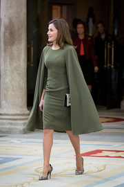 Queen Letizia of Spain chose a caped moss-green cocktail dress by Juanjo Oliva for the National Sports Awards.