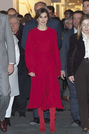Queen Letizia of Spain covered up in a loose, long-sleeve red blouse for the opening of the ARCO Fair.