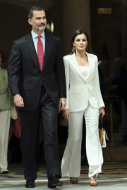 Queen Letizia teamed her suit with camel-colored cross-strap pumps by Magrit.