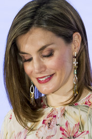 Queen Letizia dolled up her look with a pair of multicolored chandelier earrings for the Iberdrola Foundation Scholarships.